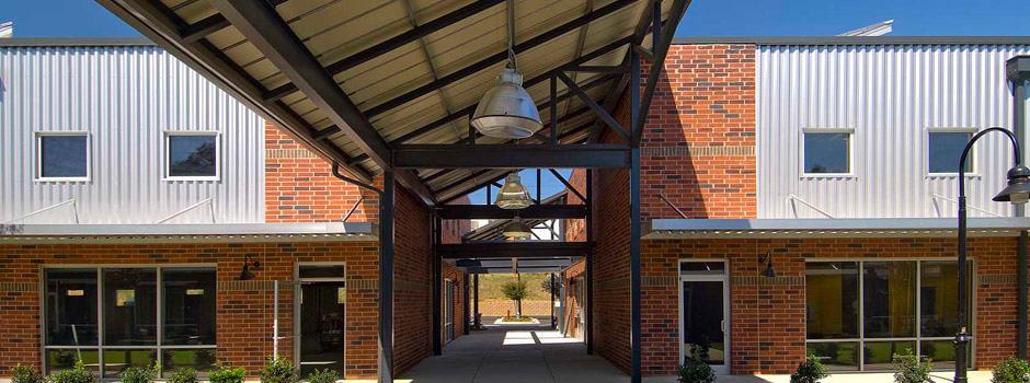 About-Slider-pollock-commercial-glassworks-entrance
